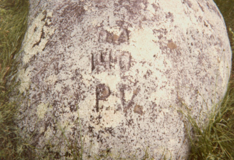 Cut into a boulder marking the temporary grave of David Acheson:   D.A.  140  P.V.