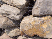 Palletized boulders wrapped with chicken wire