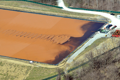 """THE DEVIL'S BACKBONE""   Marcellus shale wastewater pit holding fluids that have returned from the deep, radioactive shale. Childhood cancer clusters have emerged in SW Pennsylvania, fifteen years after fracking began. Ewing sarcoma is the most notable one."
