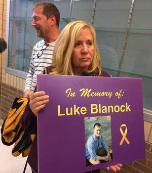 Children are never supposed to die before their parents. Luke Blanock's mother holds a poster at a public meeting at Canon-McMillan high school with the Pennsylvania Department of Health regarding the clusters of youth cancers appearing near fracking.