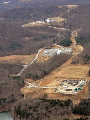 Along with other nearby well pads, these two well pads and a compressor station (middle) were cut into the forest directly above Beaver Run Reservoir in Westmoreland County, Pa. — a 1,300 acre lake that provides water to 150,000 people.