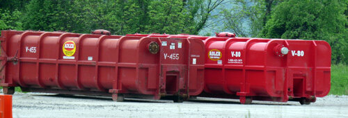 Red containers holding radioactive shale drilling and fracking waste on a Washington County, Pa. well pad.