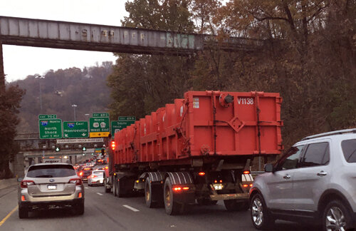 Tuesday's Parkway traffic near the Fort Pitt Tunnels in Pittsburgh included this Texas licensed tractor trailer hauling two frac waste roll-offs.