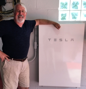 Bob next his TESLA Powerwall 2 battery backup